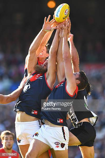 Max Gawn and Jesse Hogan of the Demons attempt to mark during the round four AFL match between the Collingwood Magpies and the Melbourne Demons at...