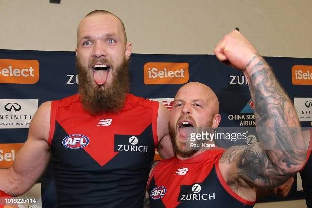 Max Gawn and Nathan Jones of the Demons celebrate following singing the club song and winning the round 22 AFL match between the West Coast Eagles...