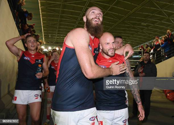 Max Gawn and Nathan Jones of the Demons celebrate winning the round 11 AFL match between the Western Bulldogs and the Melbourne Demons at Etihad...