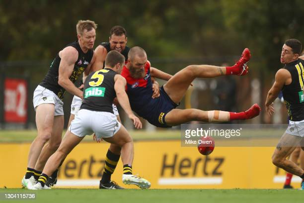 Max Gawn of Demons is tackled during the AFL Practice Match between the Melbourne Demons and the Richmond Tigers at Casey Fields on February 26, 2021...