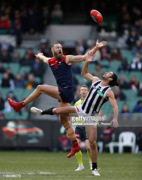 Max Gawn of the Demons and Brodie Grundy of the Magpies compete in a ruck contest during the 2019 AFL round 21 match between the Melbourne Demons and...