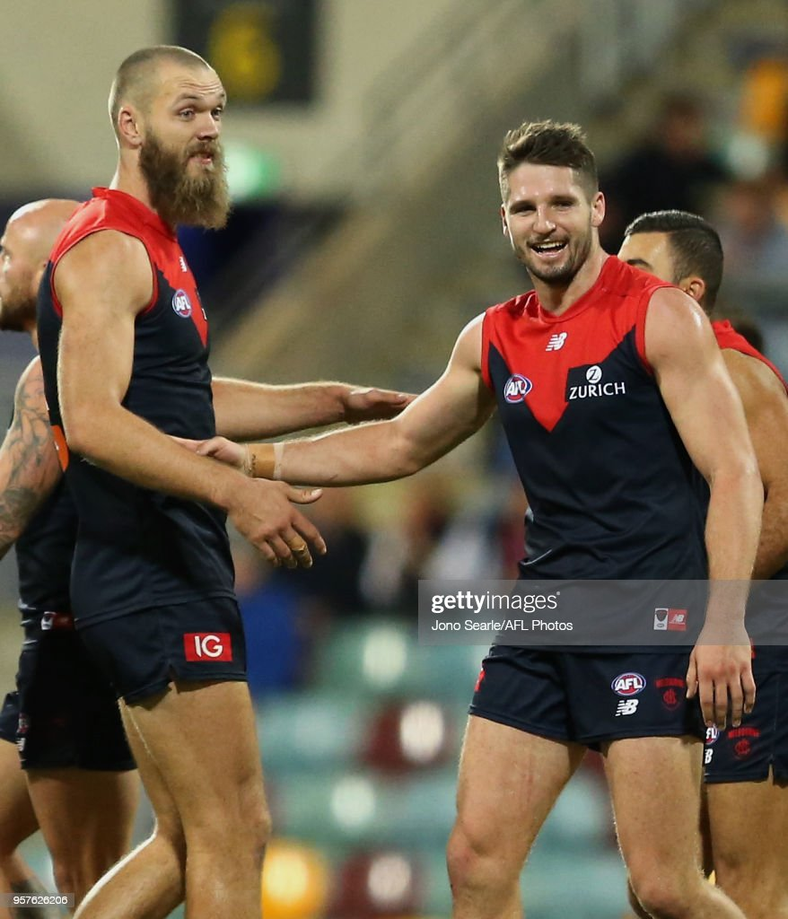 Max Gawn of the Demons and Jesse Hogan celebrate a goal during the round eight AFL match between the Gold Coast Suns and the Melbourne Demons at The Gabba on May 12, 2018 in Brisbane, Australia.