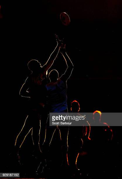 Max Gawn of the Demons and Tom Hickey of the Saints compete for the ball as the sun sets during the JLT Community Series AFL match between the...