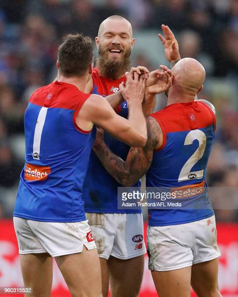 Max Gawn of the Demons celebrates a goal with Jesse Hogan and Nathan Jones of the Demons during the 2018 AFL round nine match between the Carlton...