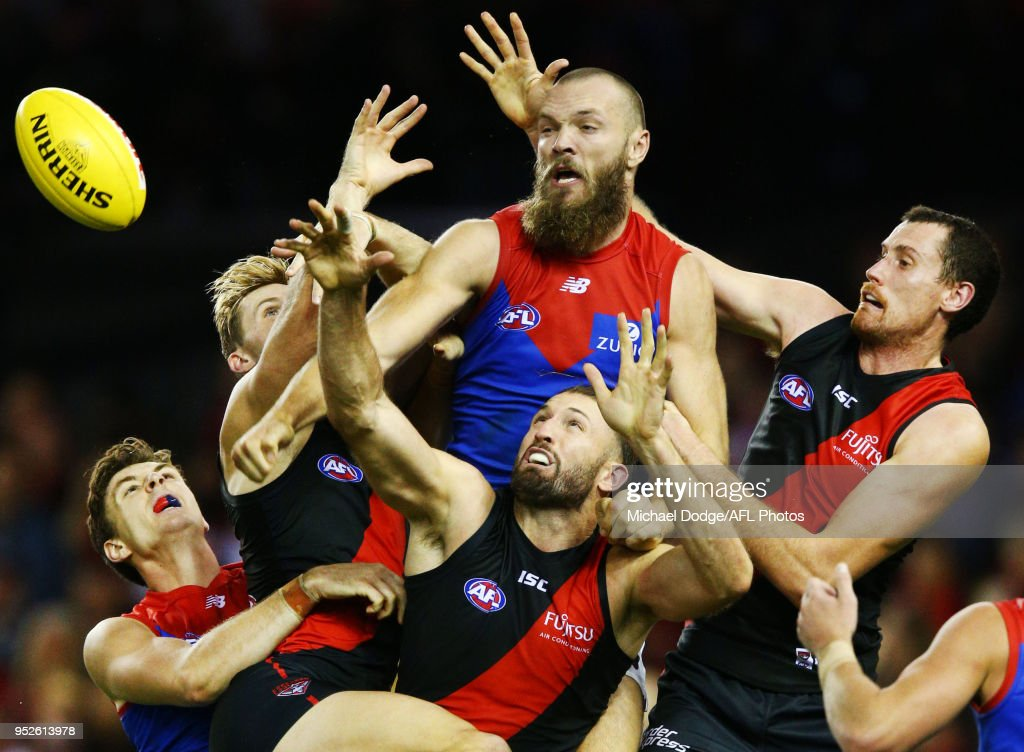 Max Gawn of the Demons (C) compete for the ball over Cale Hooker and Matthew Leuenberger of Essendon (R) during the round 6 AFL match between the Essendon Bombers and Melbourne Demons at Etihad Stadium on April 29, 2018 in Melbourne, Australia.
