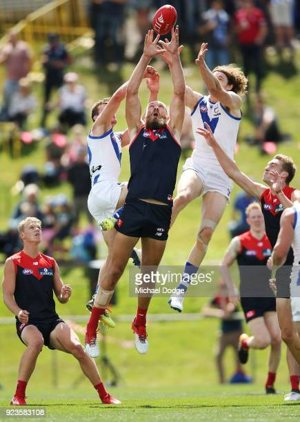 Max Gawn of the Demons competes for the ball against Shaun Atley of the Kangaroos and Ben Brown during the JLT Community Series AFL match between the...