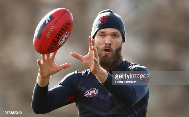 Clayton Oliver of the Demons runs with the ball during a Melbourne Demons AFL training session at Gosch's Paddock on August 16 2018 in Melbourne...