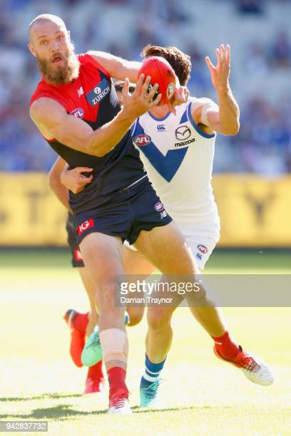 Max Gawn of the Demons handballs during the round three AFL match between the Melbourne Demons and the North Melbourne Kangaroos at Melbourne Cricket...