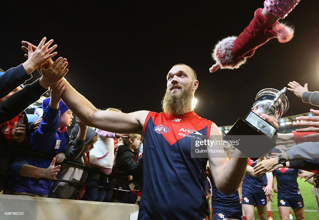 Max Gawn of the Demons high fives fans after winning the round 12 AFL match between the Melbourne Demons and the Collingwood Magpies at Melbourne Cricket Ground on June 13, 2016 in Melbourne, Australia.