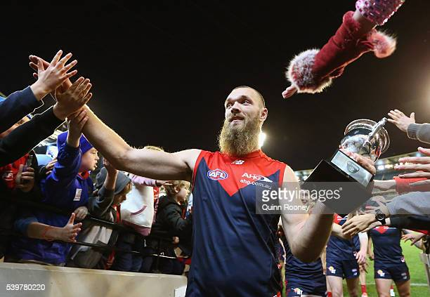 Max Gawn of the Demons high fives fans after winning the round 12 AFL match between the Melbourne Demons and the Collingwood Magpies at Melbourne...