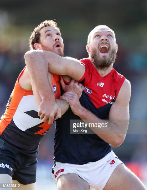 Max Gawn of the Demons is challenged by Shane Mumford of the Giants during the round 20 AFL match between the Greater Western Sydney Giants and the...