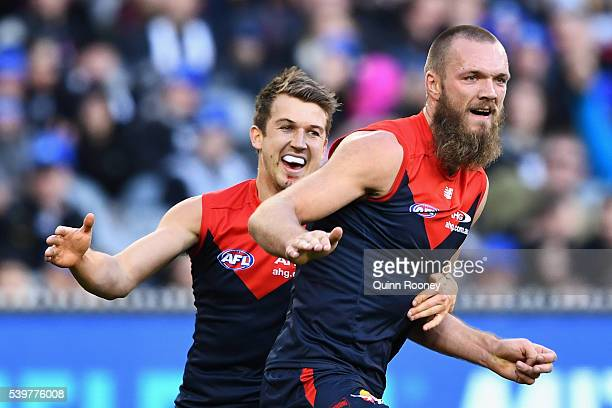 Max Gawn of the Demons is congratulated by Jack Trengove after kicking a goal during the round 12 AFL match between the Melbourne Demons and the...
