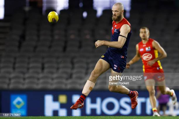 Max Gawn of the Demons kicks the ball during the round 20 AFL match between Gold Coast Suns and Melbourne Demons at Marvel Stadium on August 01, 2021...
