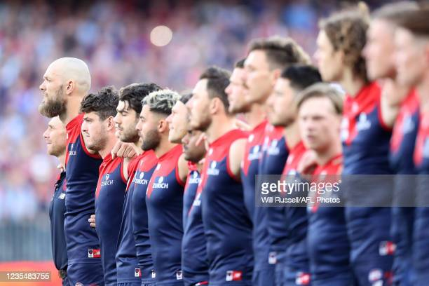 Max Gawn of the Demons line up for the Australian National Anthem during the 2021 Toyota AFL Grand Final match between the Melbourne Demons and the...