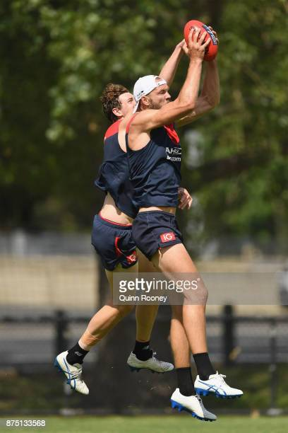 Max Gawn of the Demons marks infront of Mitchell King during a Melbourne Demons AFL training session at Gosch's Paddock on November 17 2017 in...