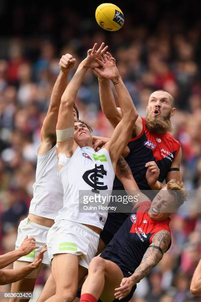 Max Gawn of the Demons spoils a mark by Charlie Curnow of the Blues during the round two AFL match between the Melbourne Demons and the Carlton Blues...