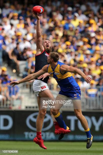 Max Gawn of the Demons wins a ruck contest against Nathan Vardy of the Eagles during the AFL Preliminary Final match between the West Coast Eagles...