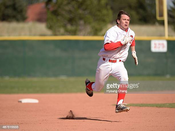 Max George of Regis Jesuit High School is heading to 3rd base in the 1st inning of the game against Mountain Vista High School at Regis Jesuit High...