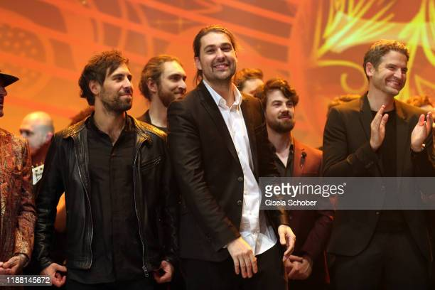 Max Giesinger and David Garrett during the 25th annual Jose Carreras Gala final applause on December 12 2019 at Messe Leipzig in Leipzig Germany