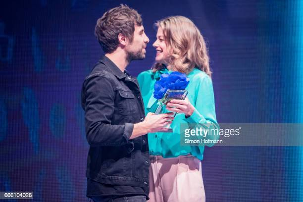 Max Giesinger is awarded by Marie Braeumer during the Radio Regenbogen Award 2017 at Europapark on April 7 2017 in Rust Germany