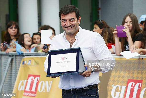 Max Giusti poses with the Giffoni Award during the Giffoni Film Festival on July 24 2014 in Giffoni Valle Piana Italy