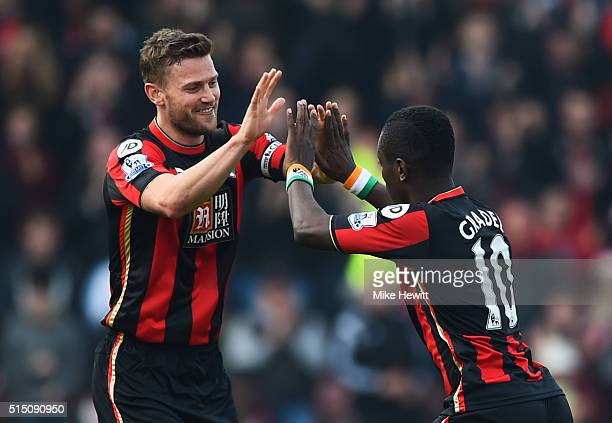 Max Gradel of Bournemouth celebrates scoring his team's first goal with his team mate Simon Francis during the Barclays Premier League match between...