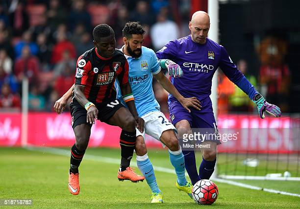Max Gradel of Bournemouth competes for the ball against Gael Clichy and Wilfredo Caballero of Manchester City during the Barclays Premier League...