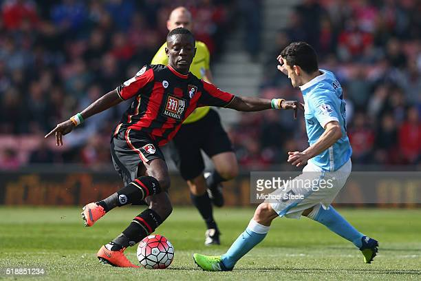 Max Gradel of Bournemouth is challenged by Jesus Navas of Manchester City during the Barclays Premier League match between AFC Bournemouth and...