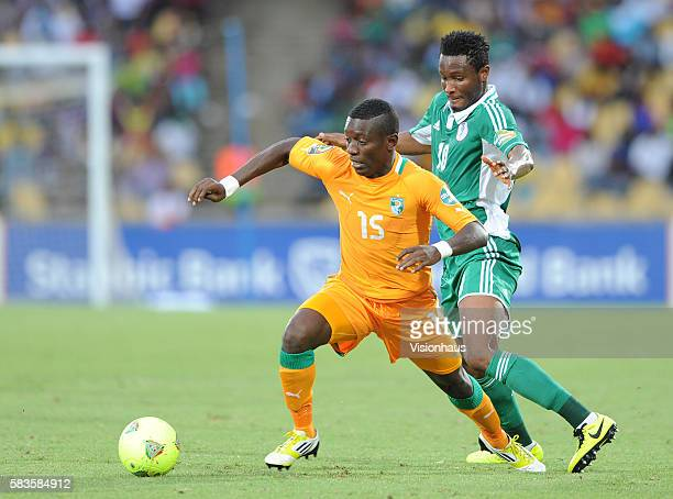 Max Gradel of Ivory Coast and John Obi Mikel of Nigeria during the 2013 African Cup of Nations Quarter Final match between Ivory Coast and Nigeria at...