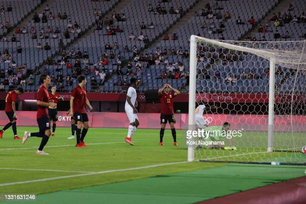 Max Gradel of Team Ivory Coast celebrates his team mate after scoring their side's second goal during the Men's Quarter Final match between Spain and...