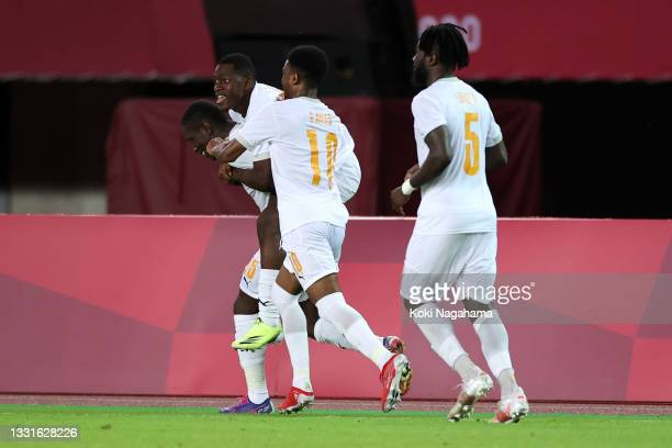 Max Gradel of Team Ivory Coast celebrates with teammates after scoring their side's second goal during the Men's Quarter Final match between Spain...