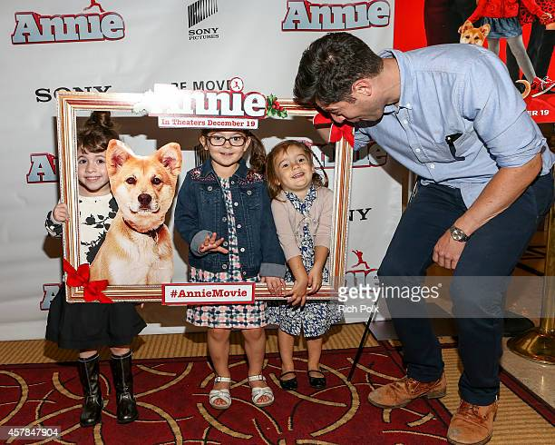 Max Greenfield and daughter Lilly Greenfield with friends at a screening of ANNIE for friends and family at Pacific Theaters at the Grove on October...