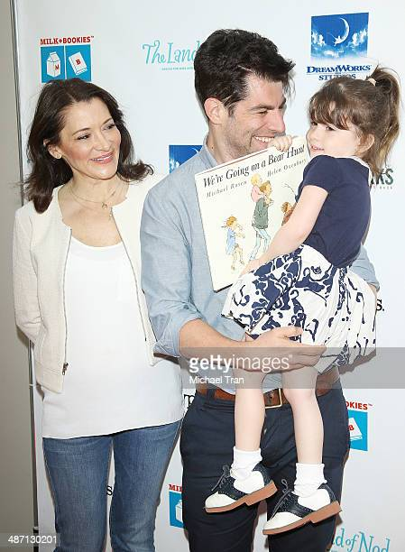 Max Greenfield wife Tess Sanchez and daughter Lily arrive at the Milk Bookies Story Time Celebration held at Skirball Cultural Center on April 27...