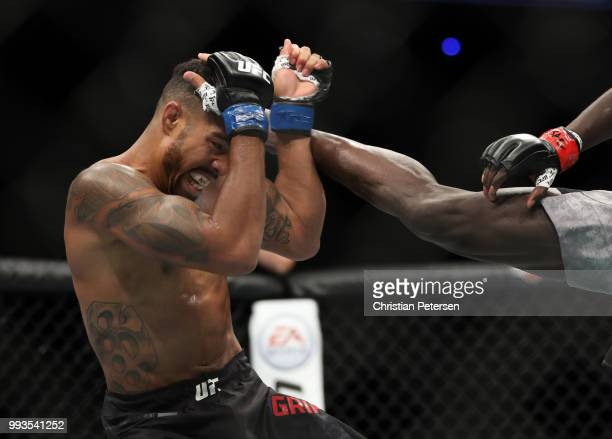 Max Griffin blocks a kick from Curtis Millender in their welterweight fight during the UFC 226 event inside TMobile Arena on July 7 2018 in Las Vegas...