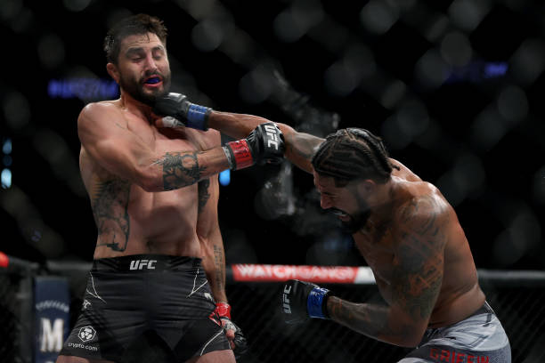 Max Griffin lands a punch on Carlos Condit in the second round in their welterweight bout during UFC 264: Poirier v McGregor 3 at T-Mobile Arena on...