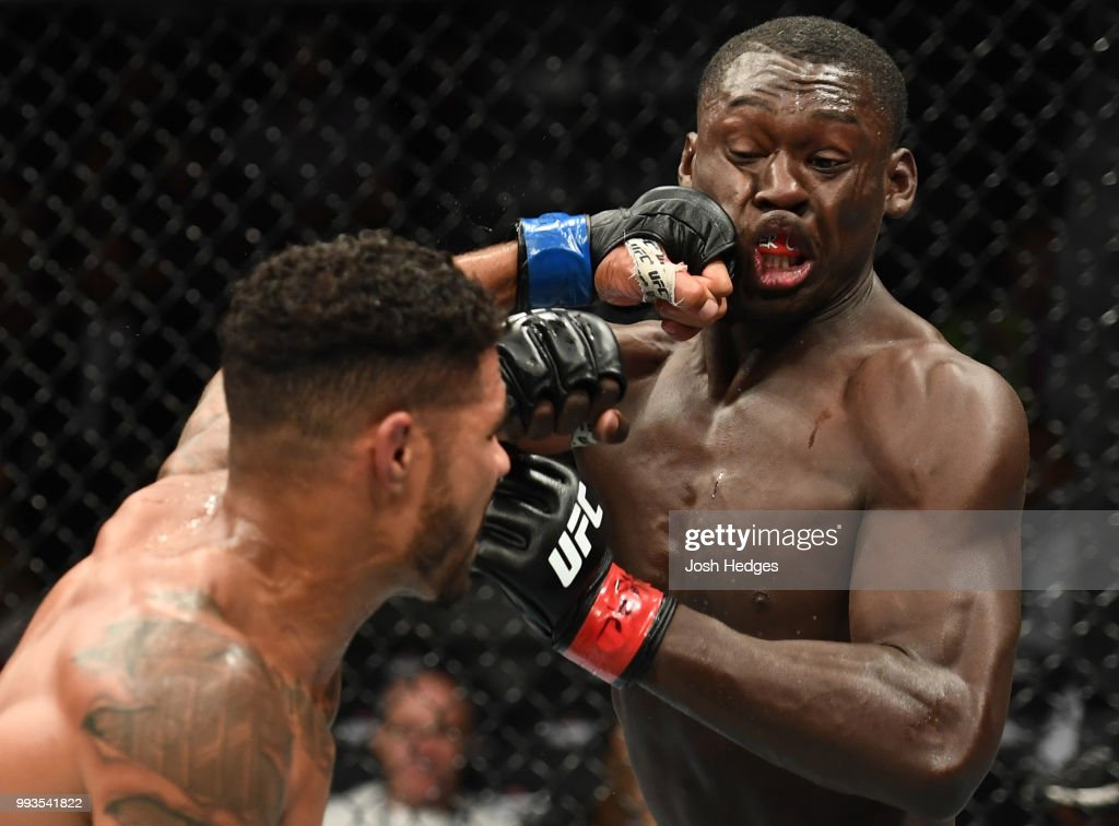 Max Griffin punches Curtis Millender in their welterweight fight during the UFC 226 event inside T-Mobile Arena on July 7, 2018 in Las Vegas, Nevada.