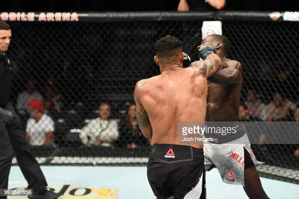 Max Griffin punches Curtis Millender in their welterweight fight during the UFC 226 event inside TMobile Arena on July 7 2018 in Las Vegas Nevada