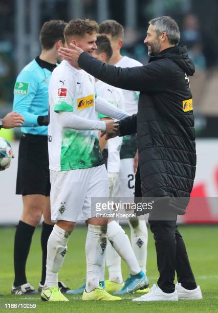 Max Grun of Borussia Monchengladbach and Marco Rose Head Coach of Borussia Monchengladbach celebrate victory after the Bundesliga match between...