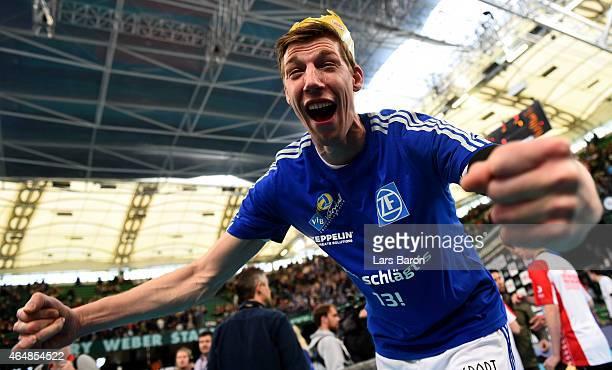 Max Guenthoer of Friedrichshafen celebrates after winning the German Men Cup Final between SVG Lueneburg and VfB Friedrichshafen at Gerry Weber World...