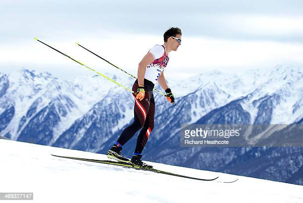 Max Hauke of Austria competes in the Men's 15 km Classic during day seven of the Sochi 2014 Winter Olympics at Laura Crosscountry Ski Biathlon Center...