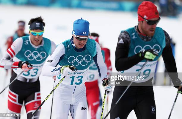 Max Hauke of Austria Matti Heikkinen of Finland and Thomas Bing of Germany compete during the Men's 50km Mass Start Classic on day 15 of the...