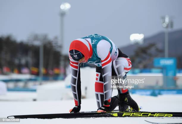 Max Hauke of Austria reacts after crossing the finish line during the Men's 15km and 15km Skiathlon CrossCountry Skiing on day two of the PyeongChang...