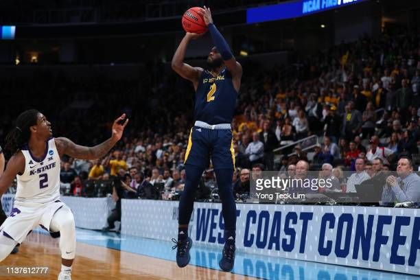 Max Hazzard of the UC Irvine Anteaters makes a threepoint shot to tie the game at the end of the half in front of Cartier Diarra of the Kansas State...