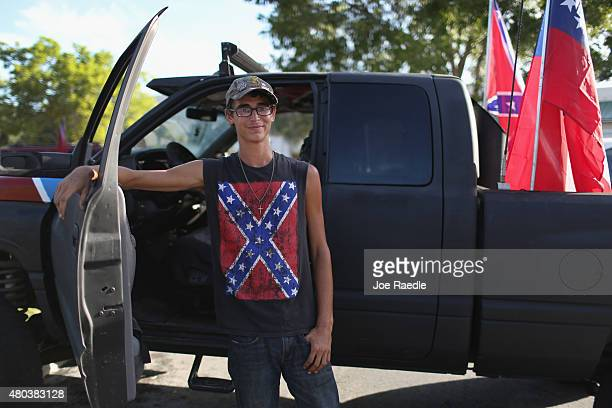 Max Hechinger displays a Confederate flag on his shirt as he participates in a rally to show support for the American and Confederate flags on July...