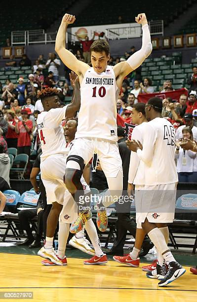 Max Hoetzel of the San Diego State Aztecs leaps in the air after winning the Championship Game of the Diamond Head Classic against the San Francisco...