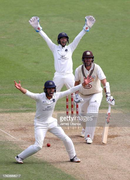 Max Holden and John Simpson, Wicketkeeper of Middlesex appeal for the wicket of Rikki Clarke of Surrey during Day 4 of the Bob Willis Trophy match...