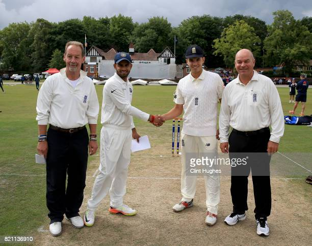 Max Holden captain of England and Himanshu Rana of India shake hands prior to play during the England U19 v India U19 match at Queen's Park Cricket...