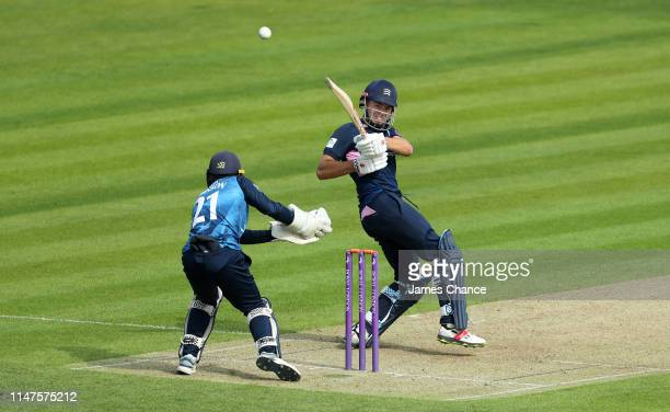 Max Holden of Middlesex bats as Kent Wicket keeper Adam Rouse looks on during the Royal London One Day Cup match between Kent and Middlesex at The...