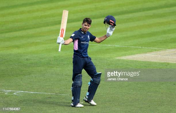 Max Holden of Middlesex celebrates his century of runs during the Royal London One Day Cup match between Kent and Middlesex at The Spitfire Ground on...