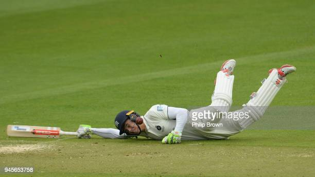 Max Holden of Middlesex dives back into his crease to avoid being run out during day one of the Specsavers County Championship Division Two cricket...